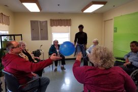 Bay Aging Adult Day Care Center members hitting balloon
