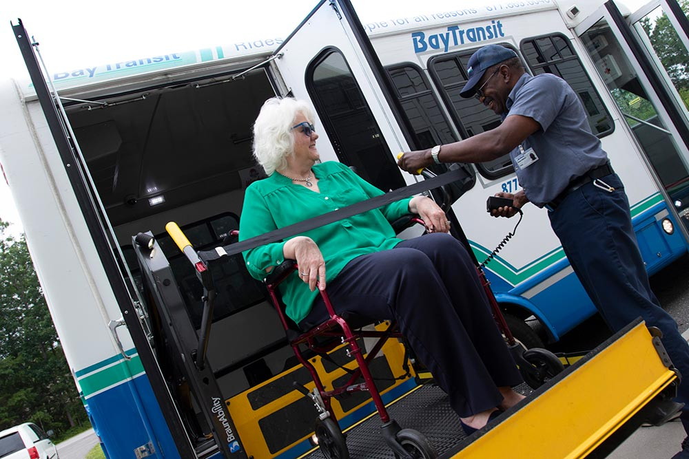 Bay Transit driver assisting passenger with wheelchair ramp