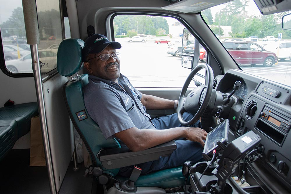 Bay Transit driver smiling on bus